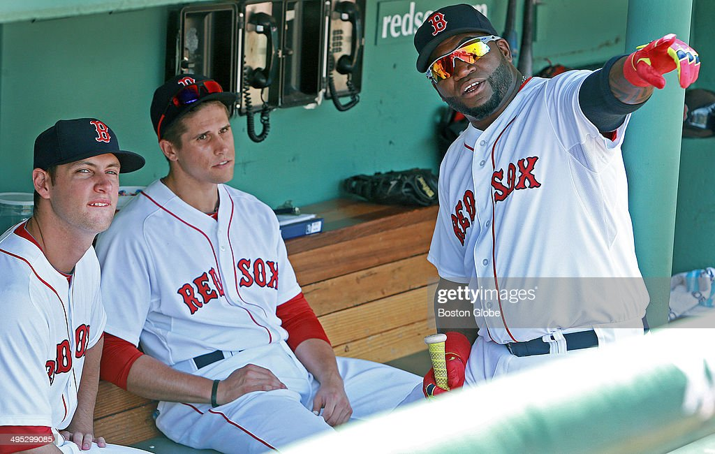 Milton, Mass. native and Boston College High School graduate Alex Hassan, left, and fellow rookie Garin Cecchini, center, were getting some advice from veteran designated hitter David Ortiz, right, as he held court in the dugout for quite awhile before the game. The Boston Red Sox host the Tampa Bay Rays in Game three of a three game series at Fenway Park. 93)