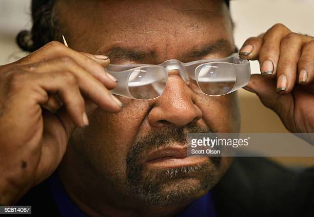 Milton McFarland of Maywood tries out a pair of Maxtv glasses at the Central Blind Rehabilitation Center at the Edward Hines Jr VA Hospital November...