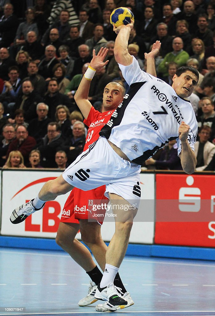 Milutin Dragicevic (R) of Kiel is challenged by Alexandros Vasilakis of Melsungen during the Toyota Handball Bundesliga match between THW Kiel and MT Melsungen at the Sparkassen Arena on February 23, 2011 in Kiel, Germany.