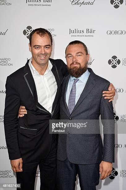 Milutin Gatsby and Leonardo DiCaprio attend a cocktail reception during The Leonardo DiCaprio Foundation 2nd Annual SaintTropez Gala at Domaine...