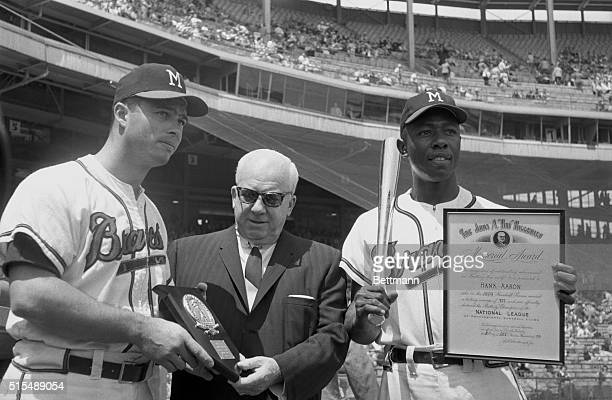 Milwaukee Braves third baseman Ed Mathews and right fielder Hank Aaron received awards before the BravesChicago Cubs game here They are shown with...