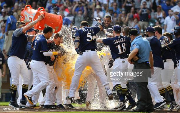 Milwaukee Brewers batter Travis Shaw is greeted by teammates after hitting a gamewinning tworun home run in the 10th inning against the Chicago Cubs...