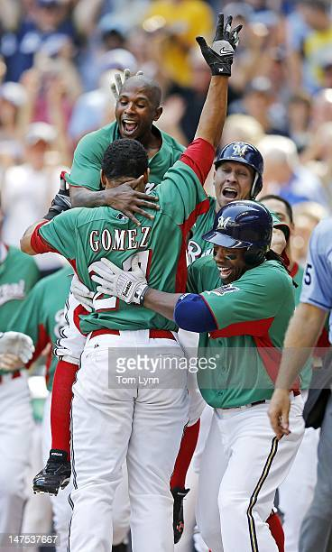 Milwaukee Brewers Carlos Gomez is greeted by Nyger Morgan and Rickie Weeks along with the whole team as he gets a walk off score after two Arizona...