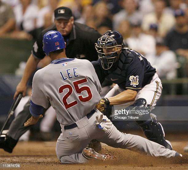 Milwaukee Brewers catcher Jason Kendall tags out Chicago Cubs Derrek Lee who tried to score from second base on a single by teammate Mark DeRosa...