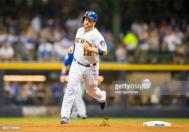 Milwaukee Brewers Catcher Stephen Vogt rounds second base after hitting a home run during the second game of the final home series between the...