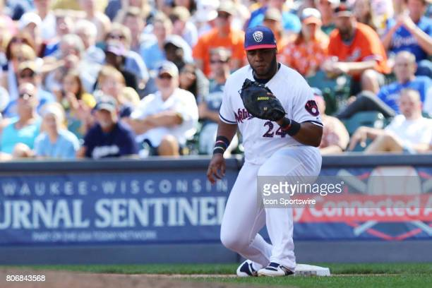 Milwaukee Brewers first baseman Jesus Aguilar catches a ball at first during a baseball game between the Milwaukee Brewers and the Baltimore Orioles...
