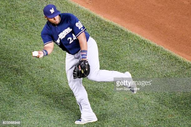 Milwaukee Brewers first baseman Jesus Aguilar fields a ground ball during an MLB game between the Milwaukee Brewers and the Washington Nationals on...
