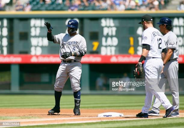 Milwaukee Brewers Infielder Jonathan Villar motions to the dugout following a base hit during a regular season MLB game between the Colorado Rockies...