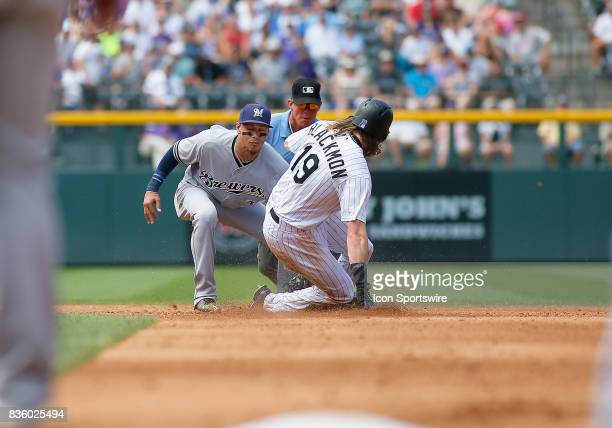 Milwaukee Brewers Infielder Orlando Arcia applies the tag to Colorado Rockies Outfielder Charlie Blackmon on a stolen base attempt during a regular...