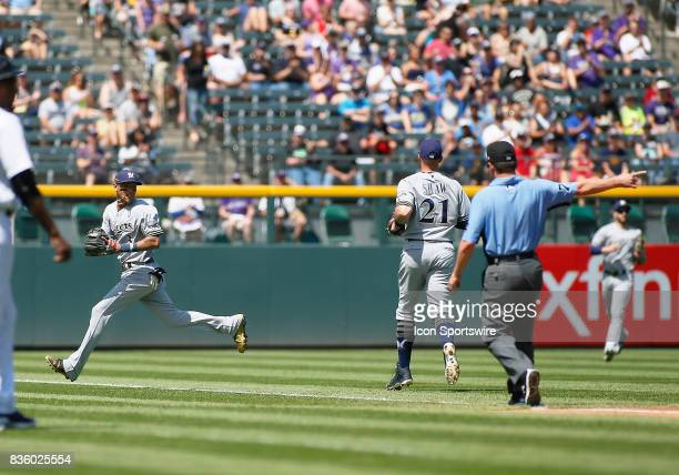 Milwaukee Brewers Infielder Orlando Arcia fields a bloop single during a regular season MLB game between the Colorado Rockies and the visiting...