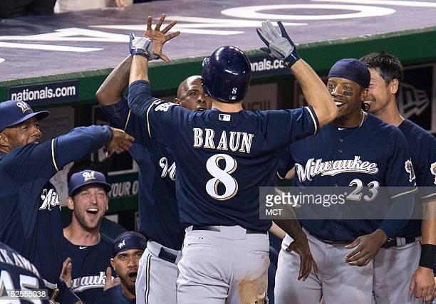 Milwaukee Brewers left fielder Ryan Braun center is swarmed by teammates after scoring the gamewinning run against the Washington Nationals during...