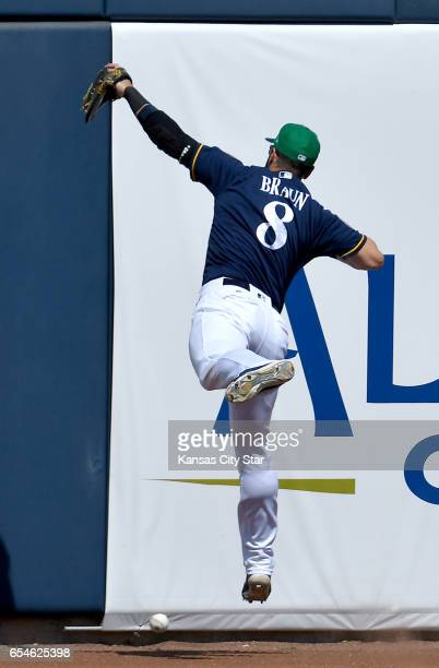 Milwaukee Brewers left fielder Ryan Braun couldn't catch up to an RBI double by the Kansas City Royals' Cheslor Cuthbert in the first inning during...