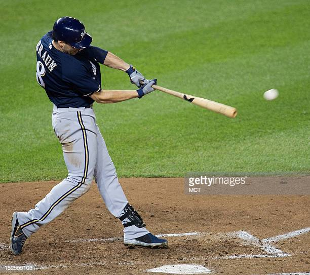 Milwaukee Brewers left fielder Ryan Braun hits a single to drive in the gametying run against the Washington Nationals in the ninth inning at...
