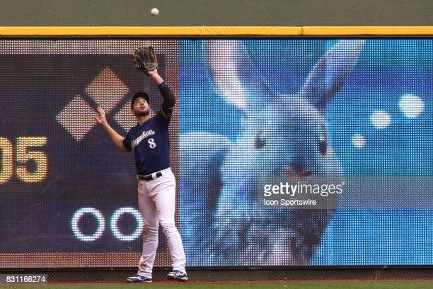 Milwaukee Brewers left fielder Ryan Braun makes a catch at the fence during a game between the Milwaukee Brewers and the Cincinnati Reds at Miller...