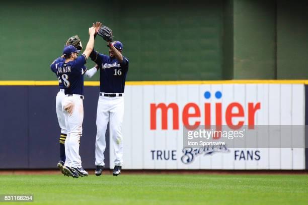 Milwaukee Brewers left fielder Ryan Braun Milwaukee Brewers right fielder Domingo Santana and Milwaukee Brewers center fielder Hernan Perez celebrate...