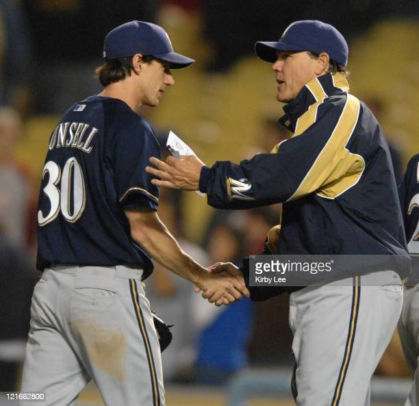 Milwaukee Brewers manager Ned Yost shakes hands with Craig Counsell after 85 victory over the Los Angeles Dodgers in Major League Baseball game at...