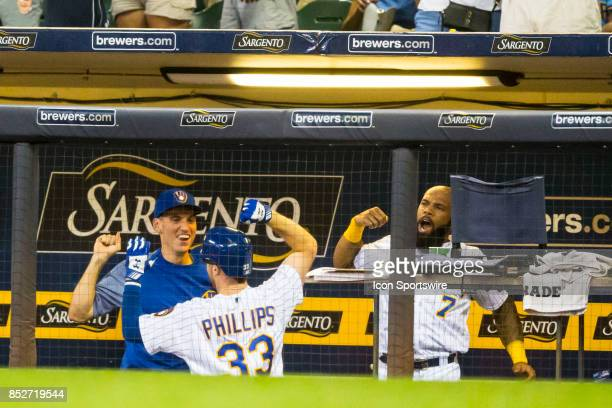 Milwaukee Brewers Outfield Brett Phillips is congratulated by his team mates following his home run during the second game of the final home series...