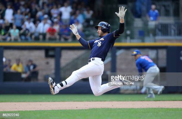 Milwaukee Brewers player Ryan Braun slides in safely at second base with a double in the 10th inning against the Chicago Cubs on Saturday Sept 23...