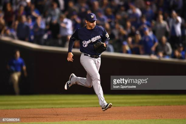 Milwaukee Brewers relief pitcher Jared Hughes runs to the mound during a pitching change during a game between the Milwaukee Brewers and the Chicago...
