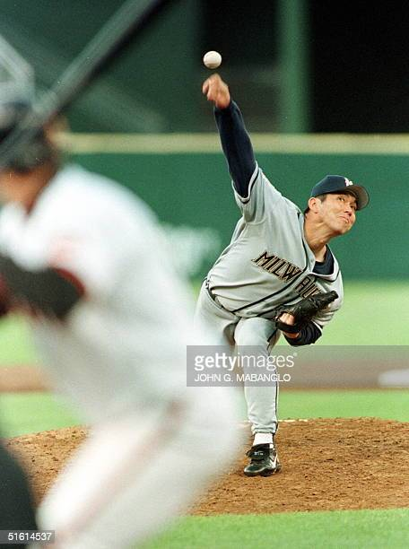 Milwaukee Brewers starting pitcher Hideo Nomo releases a pitch against San Francisco Giants player JT Snow 21 June 1999 in San Francisco Nomo is 41...