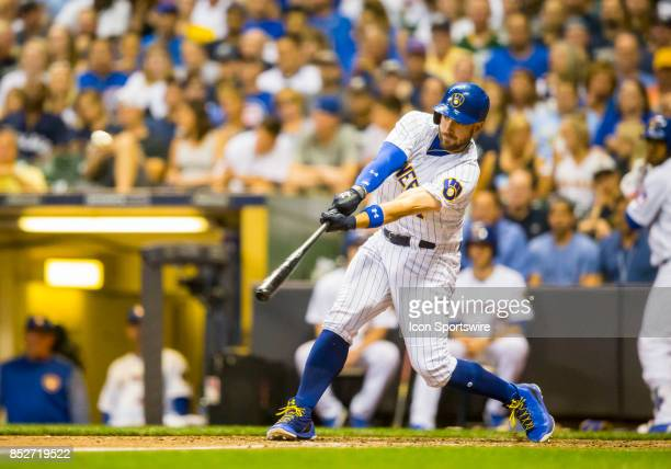 Milwaukee Brewers Third base Travis Shaw hits a long fly ball to the wall for a double during the second game of the final home series between the...