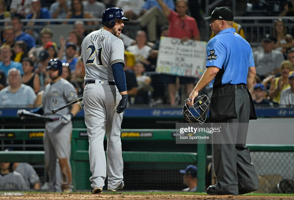 Milwaukee Brewers third baseman Travis Shaw (21) argues with umpire Mike Muchlinski after being called out on strikes in the seventh inning during the game against the Pittsburgh Pirates at PNC Park on July 18, 2017 in Pittsburgh, Pennsylvania.