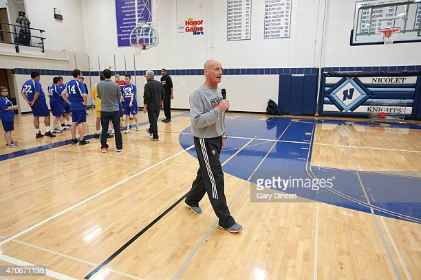 Milwaukee Bucks assistant coach Bob Bender encourages participants during a Special Olympics basketball skills clinic on February 11 2014 at Nicolet...