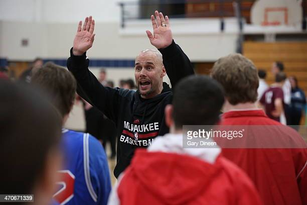 Milwaukee Bucks assistant coach Josh Oppenheimer interacts with participants during a Special Olympics basketball skills clinic on February 11 2014...