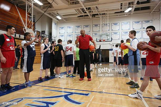 Milwaukee Bucks assistant coach Scott Williams interacts with participants during a Special Olympics basketball skills clinic on February 11 2014 at...