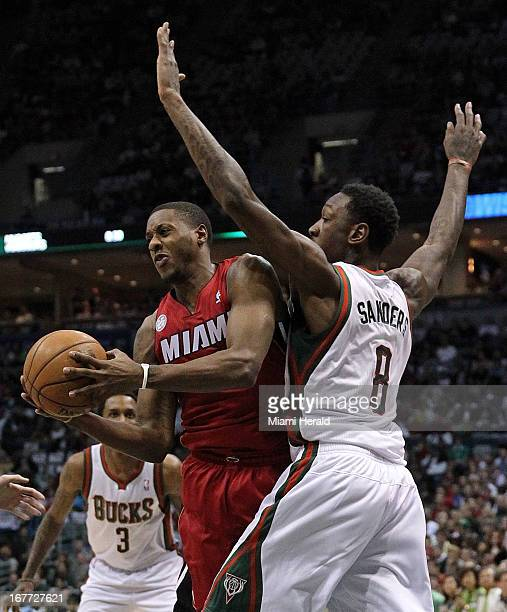 Milwaukee Bucks center Larry Sanders guards Miami Heat point guard Mario Chalmers during firstquarter action in Game 4 of the NBA's Eastern...