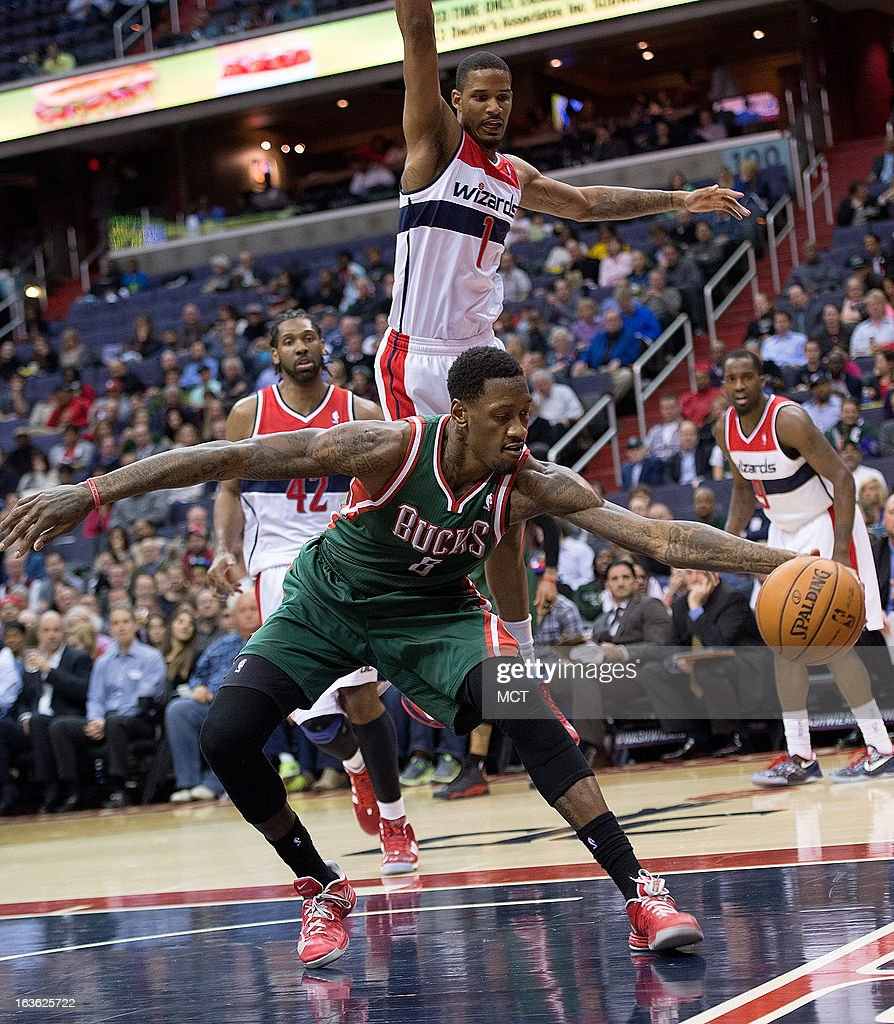 Milwaukee Bucks center Larry Sanders (8) keeps the ball from going out of bounds in front of Washington Wizards small forward Trevor Ariza (1) during the first half of their game played at the Verizon Center in Washington, D.C., Wednesday, March 13, 2013.