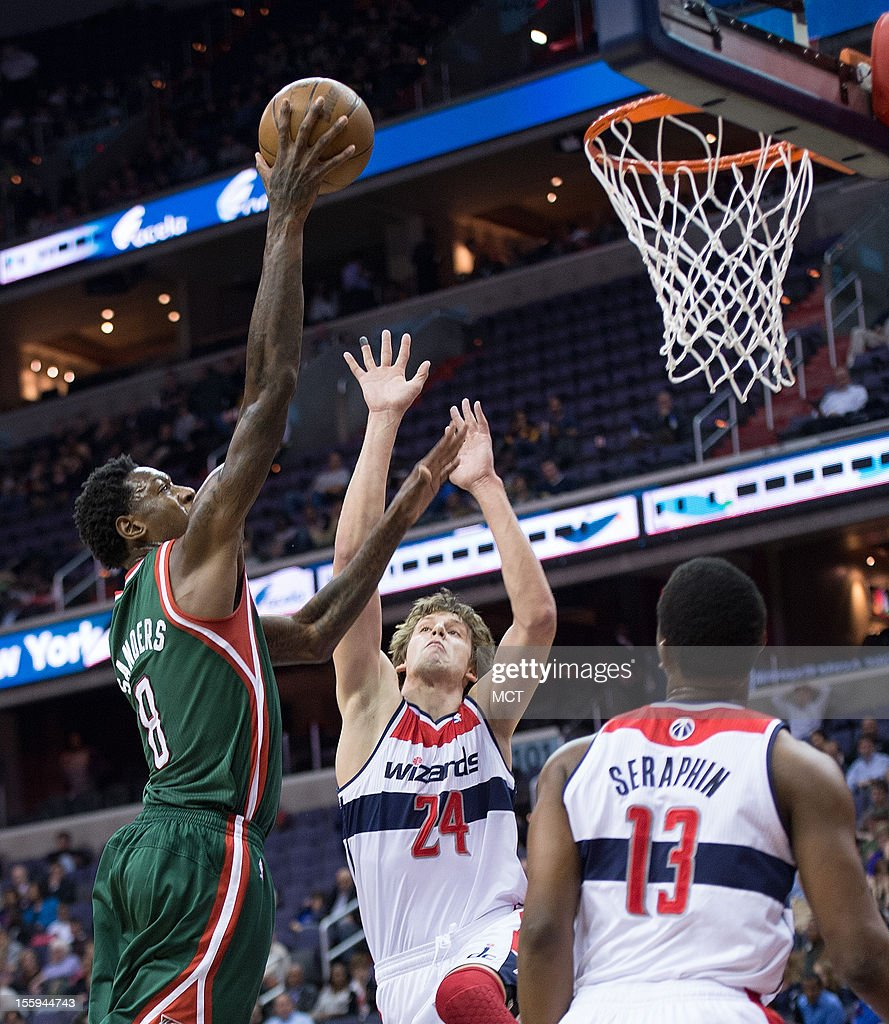 Milwaukee Bucks center Larry Sanders (8) scores over Washington Wizards small forward Jan Vesely (24) and power forward Kevin Seraphin (13) during the first half of their game played at the Verizon Center in Washington, D.C., Friday, November 9, 2012.
