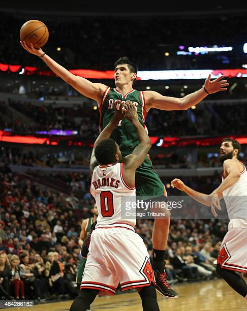 Milwaukee Bucks forward Ersan Ilyasova goes to the basket against Chicago Bulls guard Aaron Brooks during the second half on Monday Feb 23 at the...