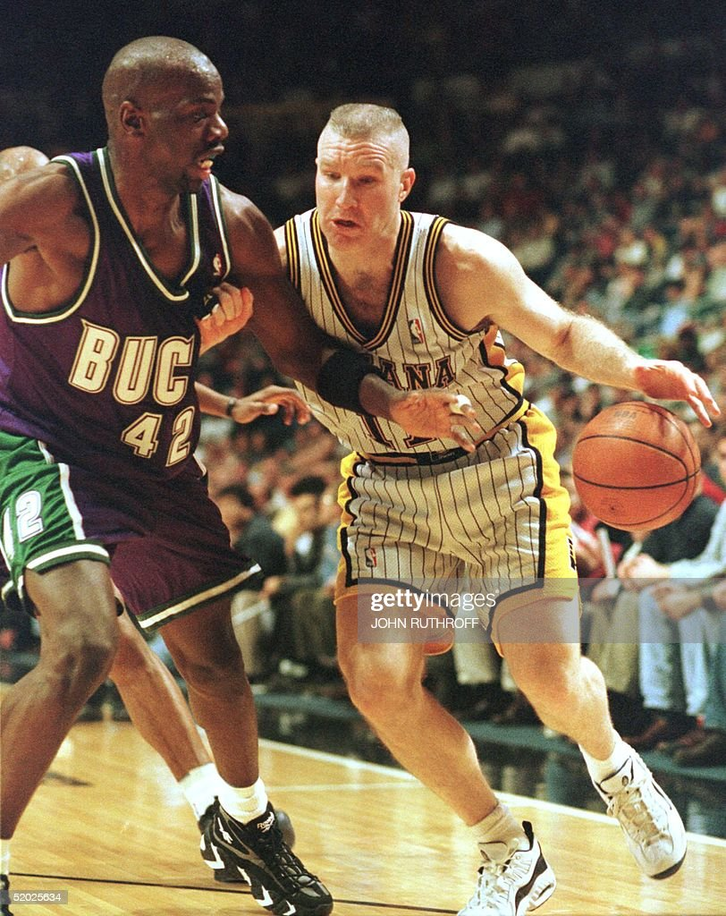 Milwaukee Bucks forward Tyrone Hill L tries to r