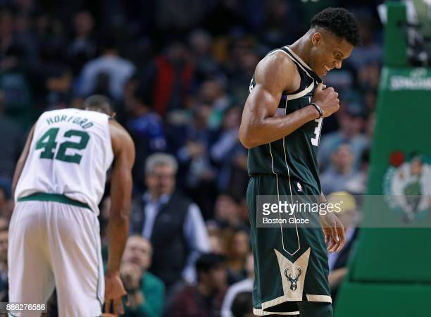 Milwaukee Bucks' Giannis Antetokounmpo reacts after he sent the Celtics' Al Horford background left to the free throw line late in the game as the...