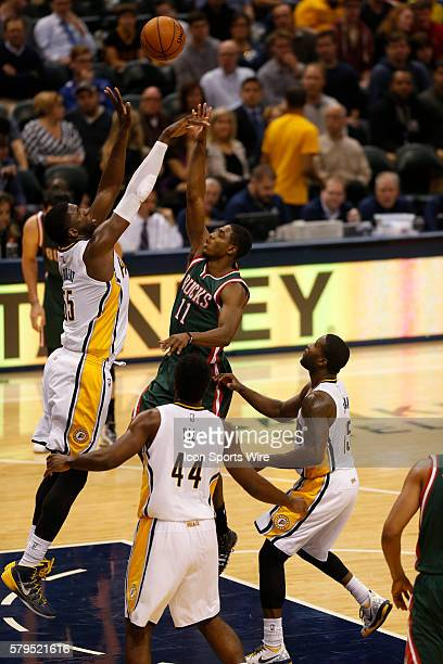 Milwaukee Bucks guard Brandon Knight puts his shot up and over Indiana Pacers center Hibbert Roy during the basketball game between the Milwaukee...
