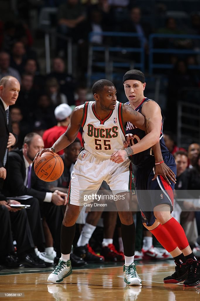 Milwaukee Bucks guard <a gi-track='captionPersonalityLinkClicked' href=/galleries/search?phrase=Keyon+Dooling&family=editorial&specificpeople=202647 ng-click='$event.stopPropagation()'>Keyon Dooling</a> #55 protects the ball during the game against the Atlanta Hawks on January 26, 2011 at the Bradley Center in Milwaukee, Wisconsin. The Bucks won 98-90.