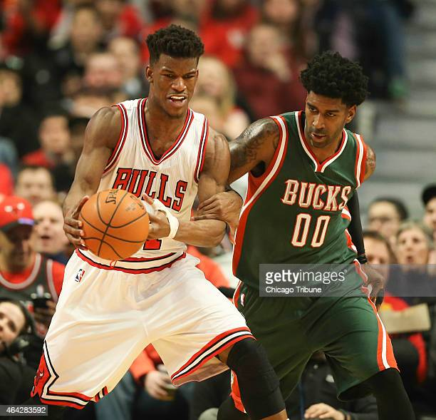 Milwaukee Bucks guard OJ Mayo grabs Chicago Bulls guard Jimmy Butler by his arm after a steal during the first half on Monday Feb 23 at the United...