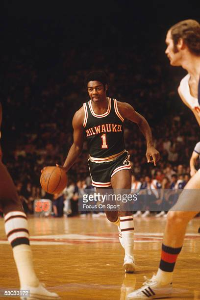 Milwaukee Bucks' guard Oscar Robertson dribbles the ball downcourt during a game NOTE TO USER User expressly acknowledges and agrees that by...