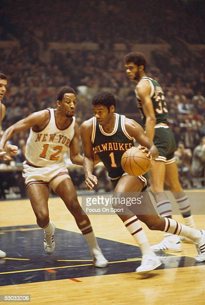 Milwaukee Bucks' guard Oscar Robertson dribbles the ball downcourt during a game against the New York Knicks NOTE TO USER User expressly acknowledges...