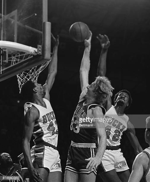 Milwaukee Bucks Mickey Johnson and 420 Harvey Catchings tried to block a shot by Boston Celtics' Larry Bird during the BostonCeltics 11/30
