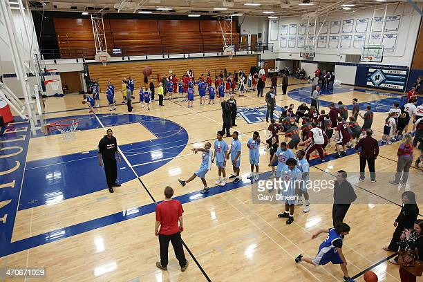 Milwaukee Bucks players and coaches interact with participants during a Special Olympics basketball skills clinic on February 11 2014 at Nicolet High...