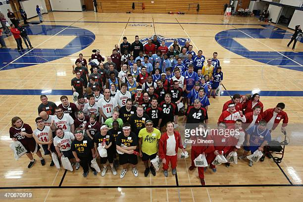 Milwaukee Bucks players and coaches pose for a group photograph with participants during a Special Olympics basketball skills clinic on February 11...