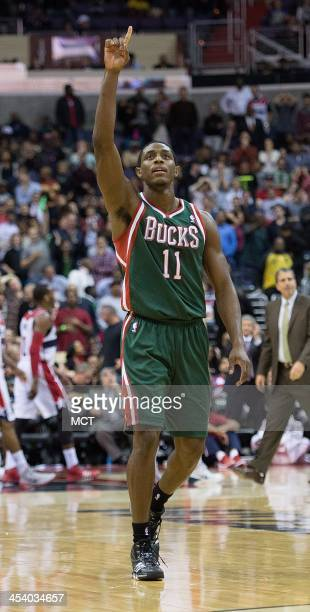 Milwaukee Bucks point guard Brandon Knight celebrates after hitting a basket against the Washington Wizards to tie the score at the end of regulation...