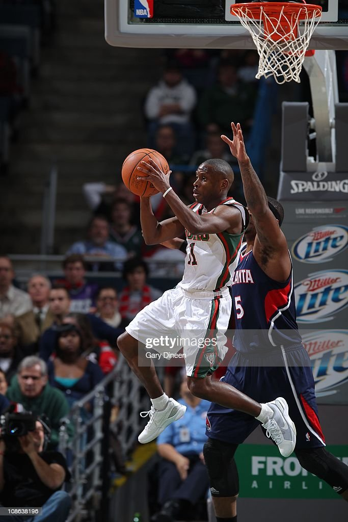 Milwaukee Bucks point guard <a gi-track='captionPersonalityLinkClicked' href=/galleries/search?phrase=Earl+Boykins&family=editorial&specificpeople=201825 ng-click='$event.stopPropagation()'>Earl Boykins</a> #11 goes to the basket during the game against the Atlanta Hawks on January 26, 2011 at the Bradley Center in Milwaukee, Wisconsin. The Bucks won 98-90.
