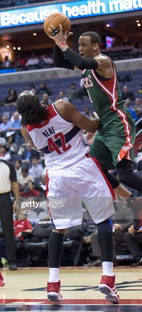 Milwaukee Bucks point guard Monta Ellis (11) charges into Washington Wizards center Nene (42) during the first half of their game played at the Verizon Center in Washington, D.C., Wednesday, March 13, 2013.