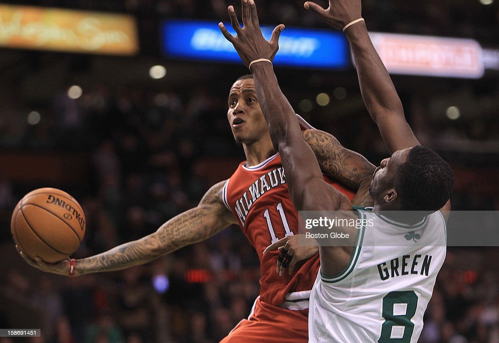 Milwaukee Bucks point guard Monta Ellis (#11) drives for a lay up late in overtime as Boston Celtics power forward Jeff Green (#8) defends as the Celtics play the Milwaukee Bucks at TD Garden.