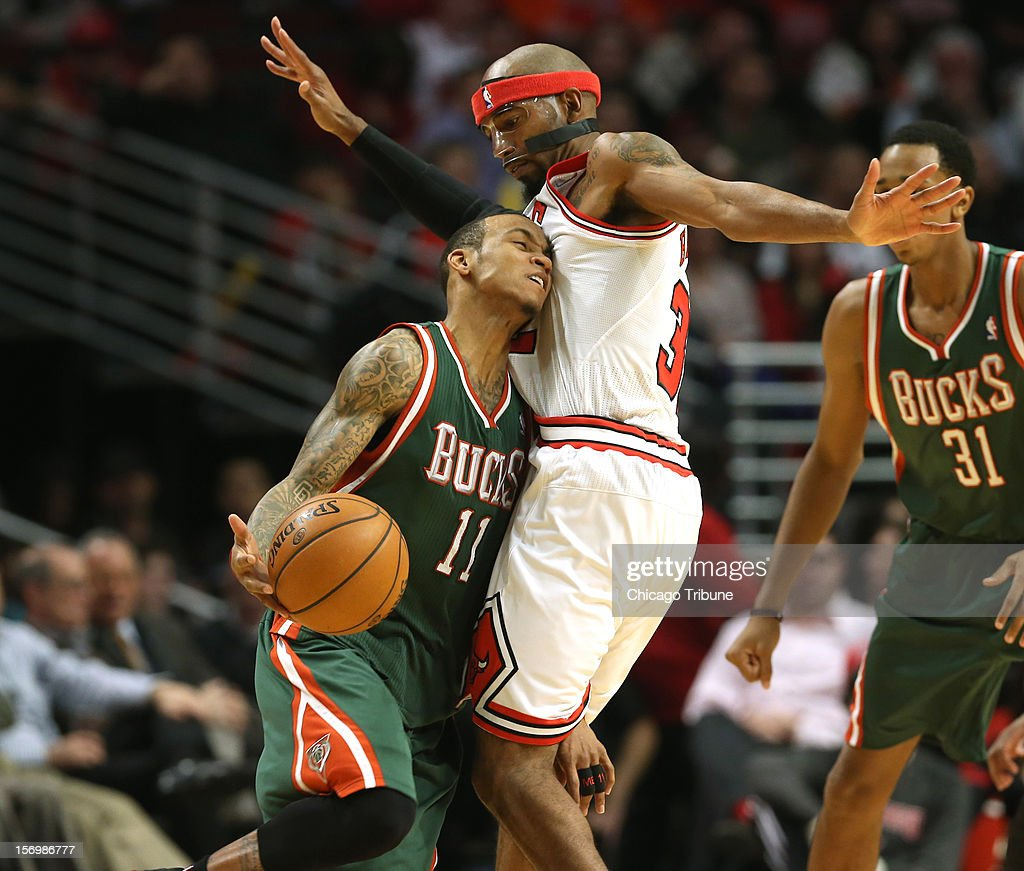 Milwaukee Bucks point guard Monta Ellis (11) tries to drive around Chicago Bulls shooting guard Richard Hamilton (32) during the first half of their game at the United Center in Chicago, Illinois on Monday, November 26, 2012.