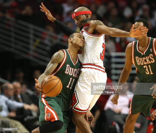Milwaukee Bucks point guard Monta Ellis tries to drive around Chicago Bulls shooting guard Richard Hamilton during the first half of their game at...