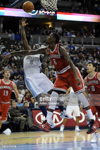 Milwaukee Bucks power forward Larry Sanders fouls Denver Nuggets point guard Ty Lawson during the second quarter at the Pepsi Center on Monday...